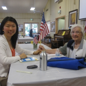 Justice bus volunteer with senior client
