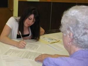 Volunteer helping a senior client