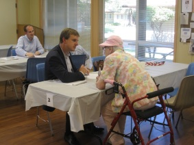 Paul Hastings Associate Jeff Michalowski meets with a senior client at a Justice Bus clinic in Napa County