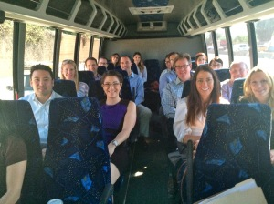 A photo of Jennifer sitting on the Justice Bus with other lawyers.