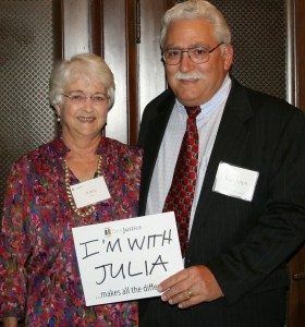 "Anne & Randy Silver at the 2014 event holding a sign that says ""I'm with Julia"""