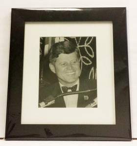 Photo of President Kennedy smiling.