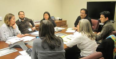 [Photo: Legal Services Nonprofit leaders discussing trainings.]