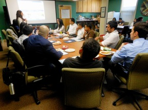 Image: Legal services organization staff person leading a training at a Justice Bus clinic last year.