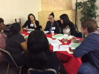 IMAGE: Black Women Lawyers Association of Los Angeles and the John M. Langston Bar Association volunteer attorneys hard at work at the Fresh Start Legal Clinic in Los Angeles.