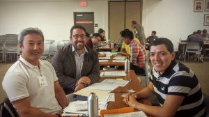 IMAGE: Suk Lee and Justin Aragon, with their client at the Greenfield Immigration Justice Bus clinic.